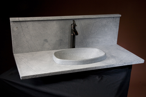 This beautiful round vessel bowl sink is artwork. The graceful top ...